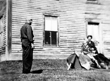 Dad surveying the yard; Louise with Gramma Brown and Sniffy the dog.