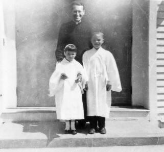 Father Mike, Mary Joan and I on our First Communion day.