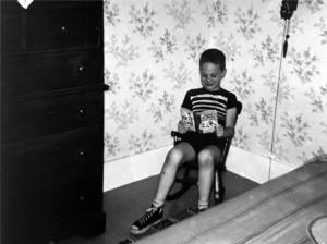 Me reading a Dennis the Menace paperback.
