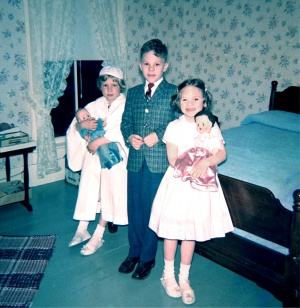 Louise, Paul, and Mary Joan on Louise's First Communion Day.