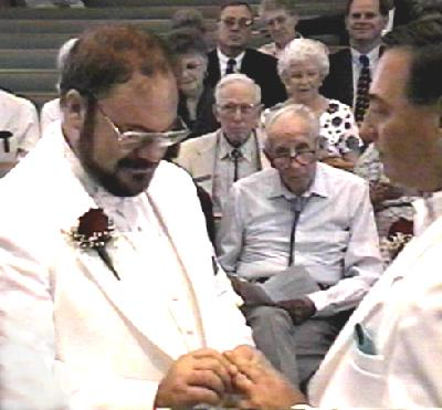 Paul and Michael exchanging rings.