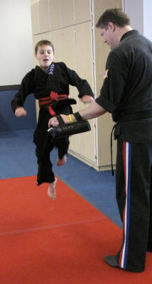 Zach high kicks to earn his second red belt.