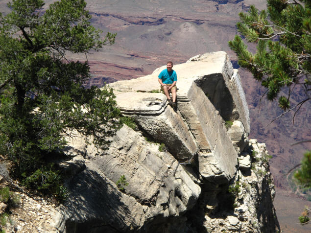 Jason sitting on an outcropping in Grand Canyon.