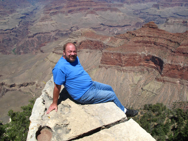 Me on the outcropping in Grand Canyon.