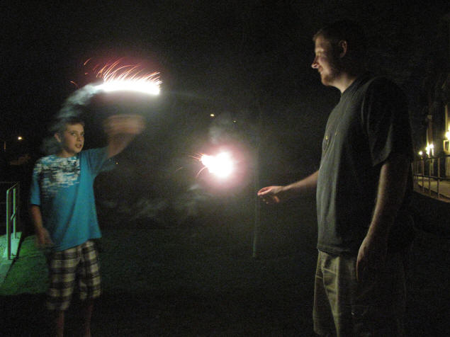 Zach and Jason shooting fireworks.