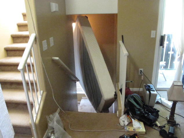 Box spring stuck in stairwell.