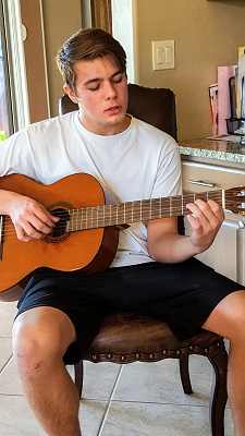 Zach on the guitar
