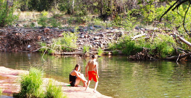 Cool water, warm day. Jenny and Zach enjoy the creek.