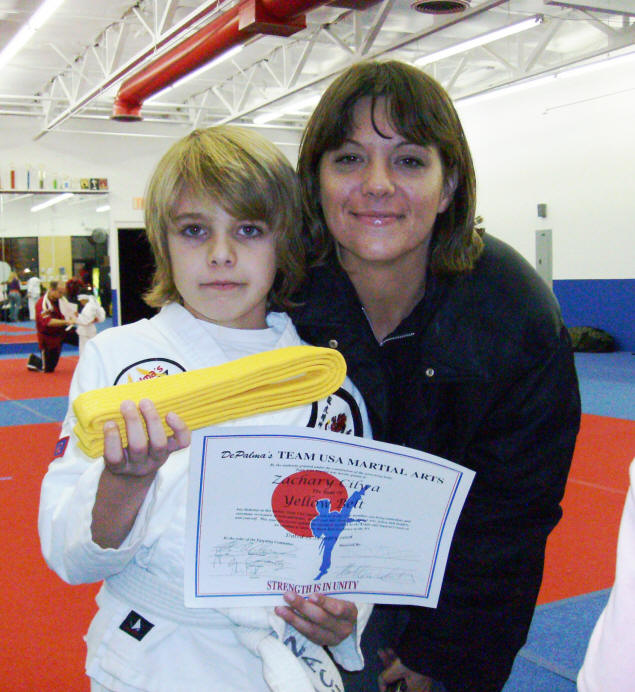 Zach, yellow belt, certificate, and proud Mom Jenny.