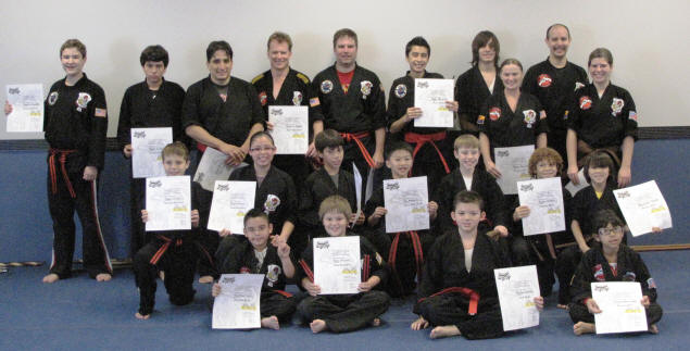 Zach and his dojomates with their new belts and certificates.
