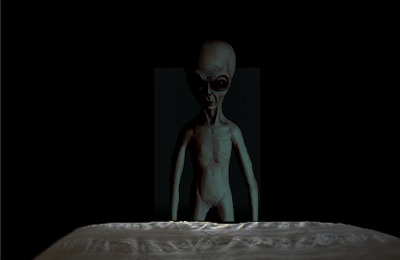 Alien standing at foot of bed.