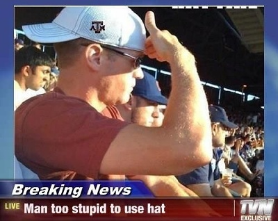 Man too stupid to use his own hat.